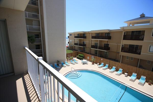 Pool view from the balcony - Private Gated Beach Access for Your Beach Holiday - New Smyrna Beach - rentals