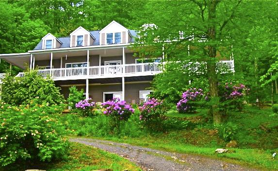 Bald Mountain House sitting creekside with long views of the Black Mountains including Mt. Mitchell. - Bald Mountain House Inn @  Wolf Laurel Ski Resort - North Carolina Piedmont - rentals