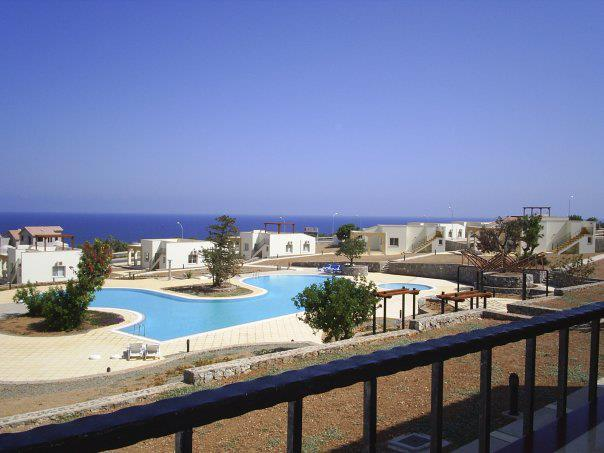 Balcony view with panoramic sea views and large swimming pool - Seaview Golf & Beach Residance - Kyrenia - rentals