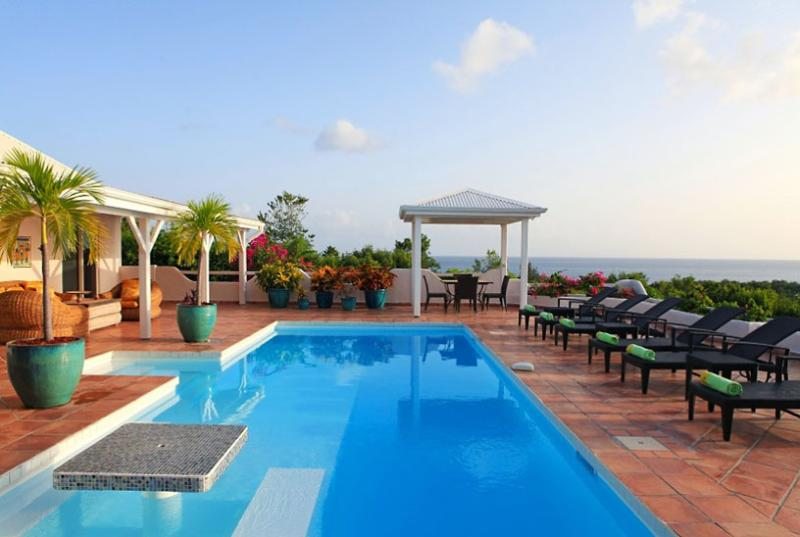 St. Martin Villa 77 Lying On The Ridge Of A Gentle Hill, Surrounded By Tropical Gardens And Allowing Spectacular Views South West Over The Caribbean Sea. - Image 1 - Terres Basses - rentals