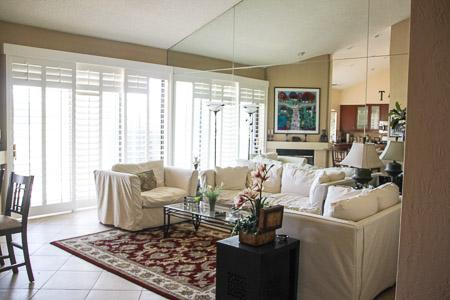 Living Room facing golf course with plantation shutter - New Remodel Beautiful Palm Valley CC   1906 sq.ft. - Palm Desert - rentals