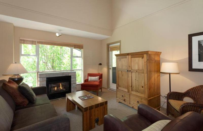 Spacious livingroom with fireplace, dining seating for 10, and private deck overlooking the Upper Village and base of the Mountain - True ski in ski out! - Whistler - rentals