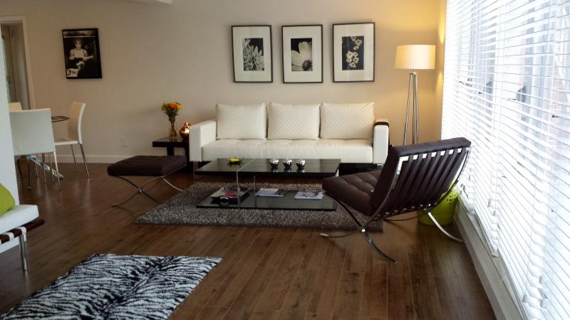 Living room - Top Vacation Rental Awarded!  Boutique Style 1/1 walking to the Beach Pool - Lauderdale by the Sea - rentals