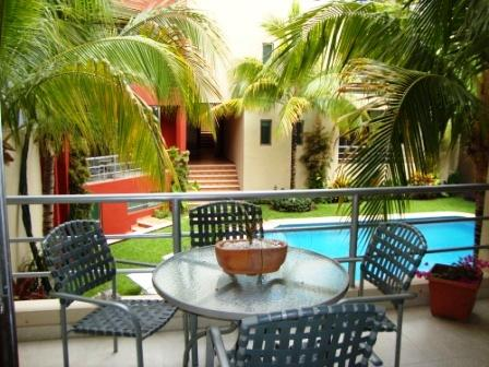 Lovely terrace overlooking the pool - Sweet Capri - 2 Bdr condo, 3 blocks to the beach - Playa del Carmen - rentals