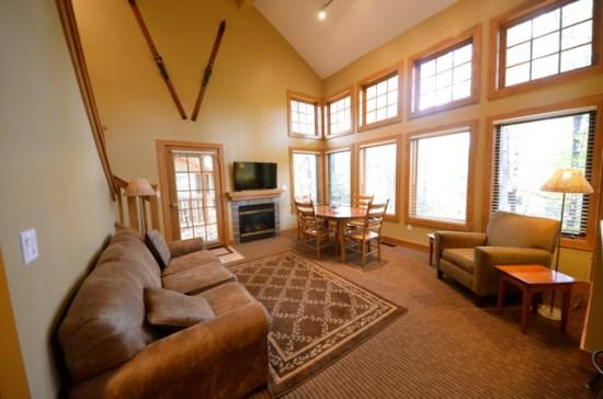 Spacious Livign Room with Queen Sofa Sleeper, Flat Screen TV, Fireplace, and Wall of Windows. - Recently Remodeled Three Bedroom Condo Located in Disciples Village, Short walk to the slopes and the village of Boyne - Boyne Falls - rentals