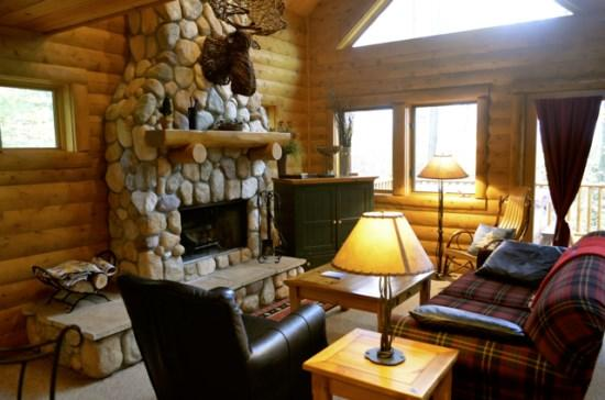 Spacious Livign Room with Queen Sofa Sleeper, Wood Burning Fireplace, Television, Fireplace, and Wall of Windows. - 3BR Mountain Cabin - Skiers Paradise, Private, Sleeps 12, Wood Burning Fireplace - Boyne Falls - rentals