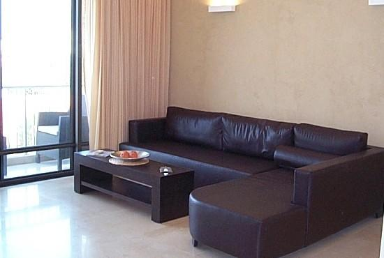 lounge with walk-out balcony with seaview - Designer  -1 Bedroom with Sea view & Pool - Herzlia - rentals