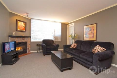 Spacious living room with Fireplace and sofa bed - Bear Lodge, Heart of Whistler Village 2 Bed condo Unit # 215 - Whistler - rentals