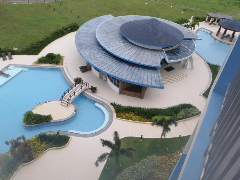 Pool and Clubhouse seen from balcony - Condo in Luxury Resort near Shangri La Mactan Cebu - Lapu Lapu - rentals