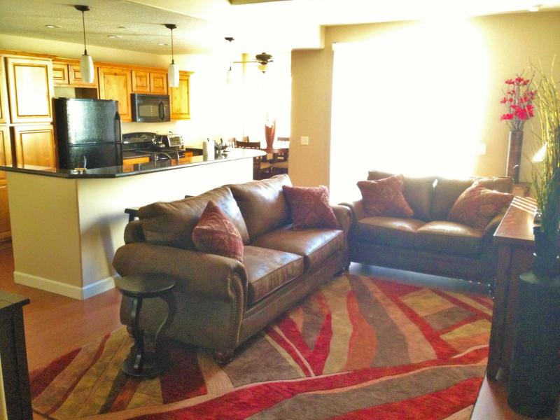 Plenty of seating around the large flat-screen TV.  This sofa also folds out. - Exquisite Condo Blocks from the Convention Center - Salt Lake City - rentals