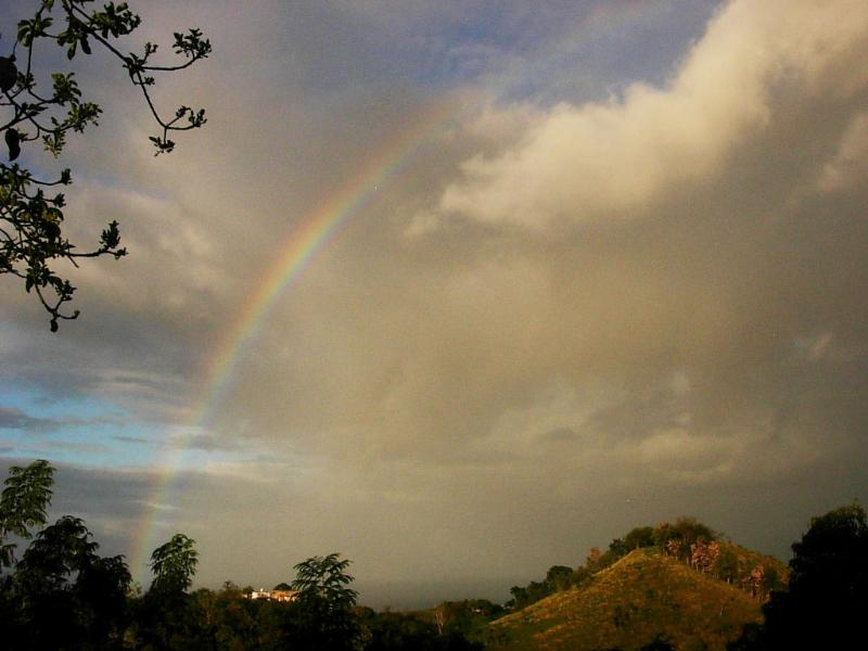 Rainbow and the mountain view from the terrace - Hilltop Apartment with Spectacular View of Ocean - Rincon - rentals