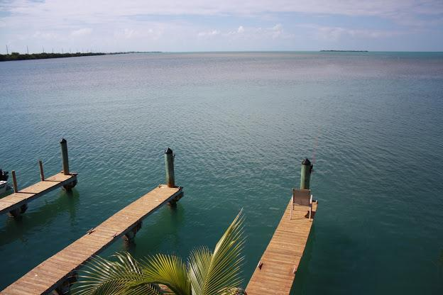 A water view facing due west overlooking the boat slips that come with each Villa - If Comfort, Fun, Fishing and Views are on your List Stay Here - Conch Key - rentals