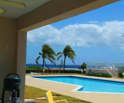 View from the patio - First Floor Oceanfront Condo in Top Location! - West Bay - rentals