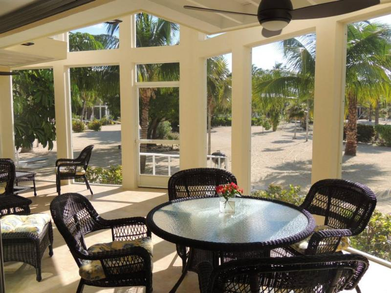 The large lanai with its view of the beach and cove - Starboard Kai Beachfront Home Rum Point Cayman Kai - Cayman Kai - rentals
