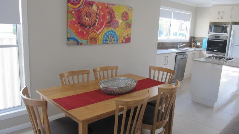 Open plan living/dining area which opens out onto a private courtyard with electric BBQ - Stylish New Dalby Apartments Centrally Located - Dalby - rentals
