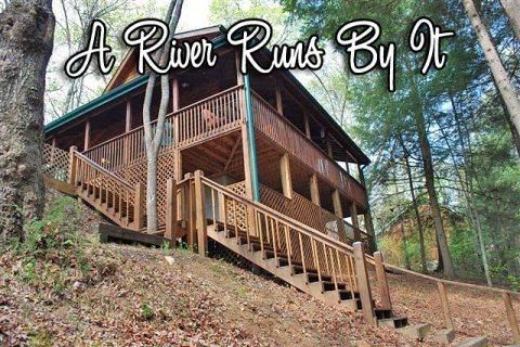 LOWER VIEW OF CABIN - A RIVER RUNS BY IT- 3BR/ 2 BA CABIN ON BEAUTIFUL FIGHTINGTOWN CREEK, SLEEPS 6, HOT TUB, FIRE PIT, NATURE TRAIL, FIREPLACE, SAT TV, WIFI, ONLY $125 A NIGHT! - Blue Ridge - rentals