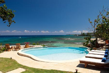 Secluded treasure, Hidden Bay Villa with pool, hot tub, cliffside patio & full friendly staff - Image 1 - Runaway Bay - rentals