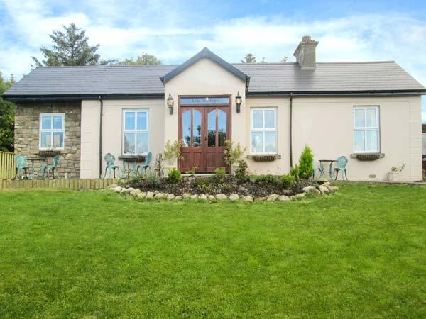 LILY COTTAGE, pet friendly, character holiday cottage, with a garden in Swinford, County Mayo, Ref 8083 - Image 1 - Swinford - rentals