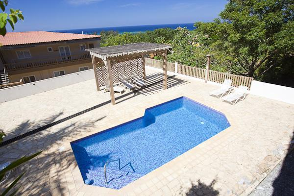 View from Deck of Pool & Caribbean Reef - Roatan Island - The Views - Amazing 2 Br/2Ba Caribbean Condo with Views & Pool - West End - rentals