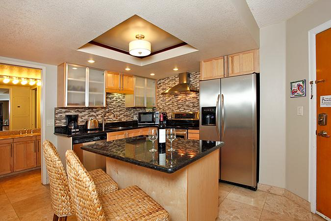 Unit A101 with stylish remodeeld kitchen with granite counters and stainless steel appliances - $149 JUNE SPECIALS! Gorgeous Remodeled Maui Banyan - Kihei - rentals