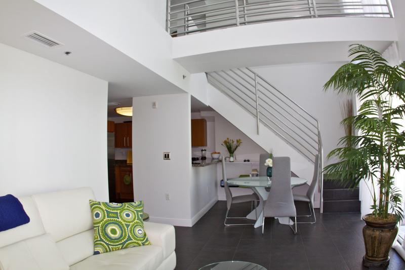view of kitchen and dining area with catwalk overhead - Contemporary 2Story Loft w/ 2 Balconies & Catwalk! - Miami Beach - rentals