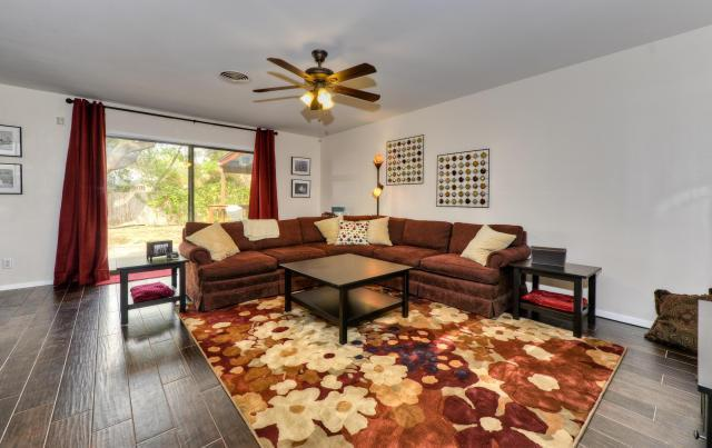 Main Living Room with all New Dark Italian Wood Tile, Flat Screen TV, Doors to the Patio, and more! - Beautiful 4 bedroom, 2300 sqft! - Austin - rentals