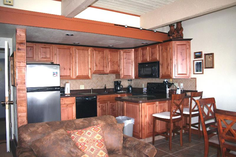 Kitchen with quartz countertops - SKI-IN/OUT  Club B Slopeside Condo  w/Spa Facility - Steamboat Springs - rentals