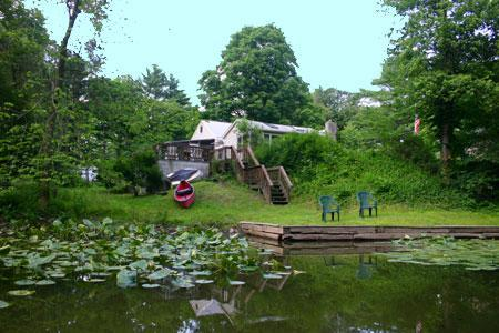 boat launce from backyard at esopus creek cottage - view towards back of house, deck, yard - Catskills Hudson Valley Vacation Cottage Getaway - Saugerties - rentals