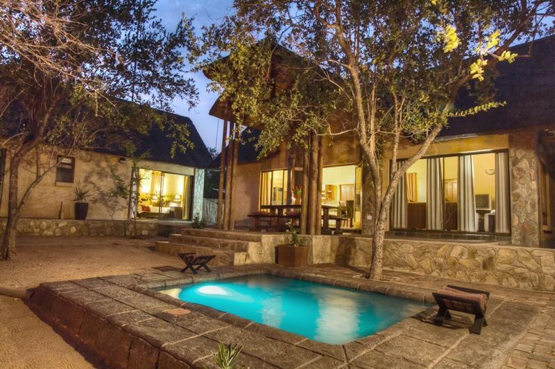 Pool area - one bedroom wing left - open plan area middle - Warthog Rest Private Lodge - Hoedspruit - rentals