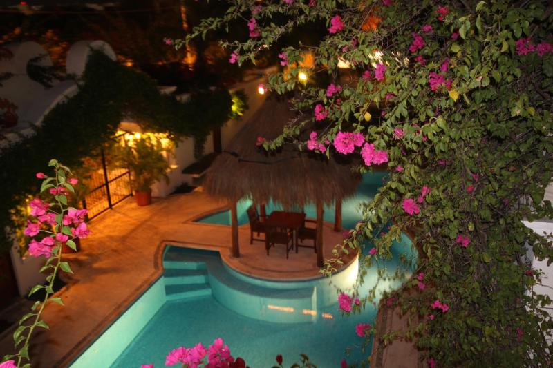 The view of the pool at night from the balcony - Beautiful Condo Overlooking Pool in Playa - Playa del Carmen - rentals