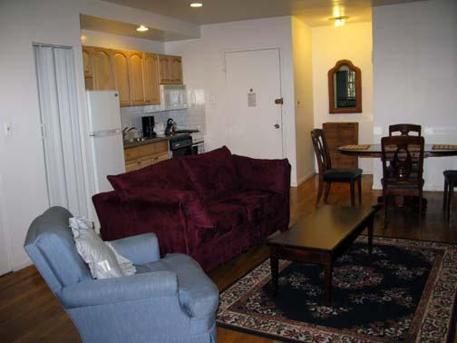 View of living room with modern fully equipped kitchen - Lincoln Center, Central Park West,   Townhome Apt - Manhattan - rentals