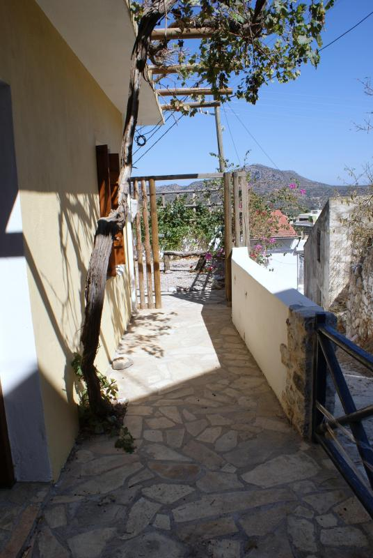 The side of the house towards the garden. - 1 bedroom house  with views over olive groves - Crete - rentals