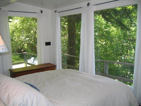 Master bedroom- windows surround you and let in the beautiful light - 2 Bedroom Waterfront Cottage-  Skaneateles Lake - Skaneateles Lake - rentals