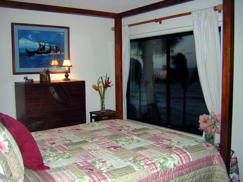 Bedroom with evening view of ocean - Delux white water ocean view condo - Princeville - rentals