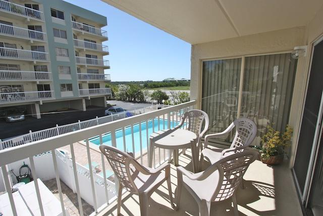 Balcony overlooking the pool - Two Bedroom Poolside Condo in Indian Shores, FL - Indian Shores - rentals