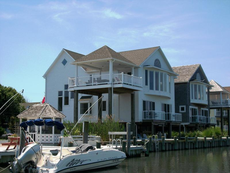 Located directly on deep water Chincoteague Channel overlooking beautiful Chincoteague Bay. - Moorings North, Waterfront, 5BR, 4BA, Elevator - Chincoteague Island - rentals