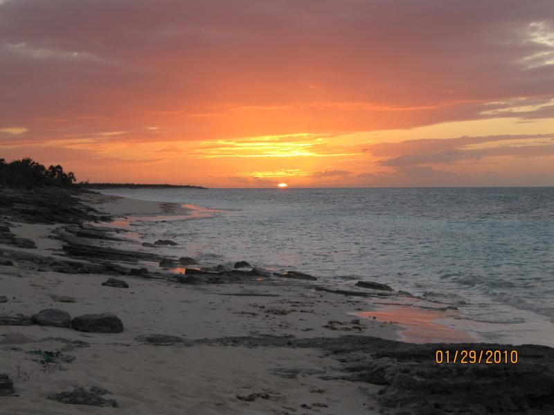 Picture yourself watching this sunset from our beach. - Ocean view home, with an adjoining in-law suite. - Whitby - rentals