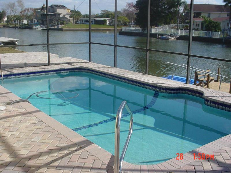 Our Solar Heated, Pool overlooking the canal to the Gulf of Mexico - Enjoy it all-Screened Solar Heated Pool-Dock-Gulf - Hernando - rentals