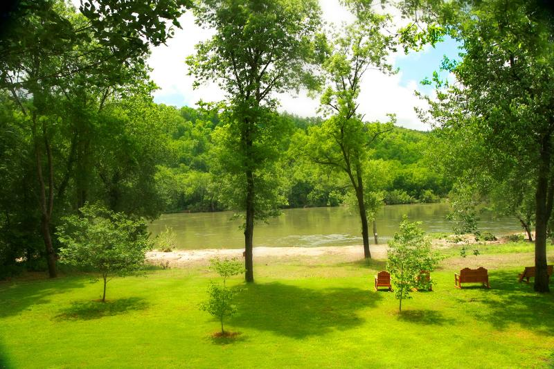 Back yard looking out ont White River - White Riverfront  Luxury Home Trout fish in style - Norfork - rentals