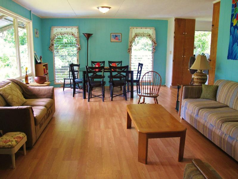 great room, three comfy couches, entertainment center, books and games , local art, tropical view - Discover Big Island Bliss in Puna! 7th night free! - Pahoa - rentals