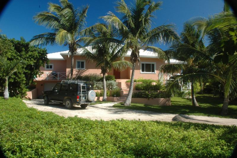 Tropical foliage envelops the beautiful home - Elegant, serene home on spectacular beach - Governor's Harbour - rentals