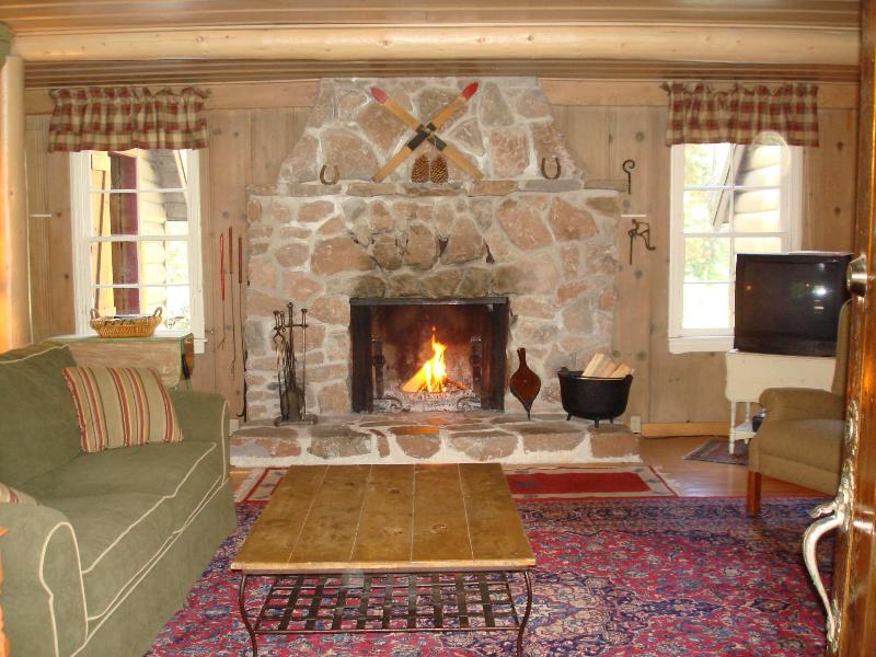Living Room with wonderful big fireplace & Queen sleeper sofa. - 1930s Tahoe Cabin on the Yuba River - A REAL Cabin - Soda Springs - rentals