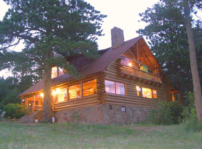 Main Lodge at dusk - The Historic Overlook Ranch and Cabins - Estes Park - rentals