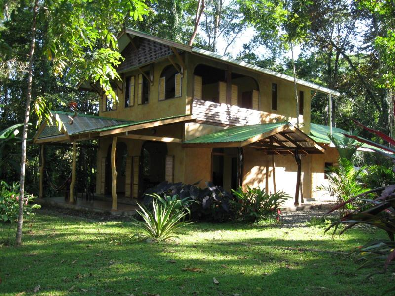 Casa Stella's side porch and front entrance - Casa Stella - Rainforest Home Rests on 1.5 acres - Puerto Viejo de Talamanca - rentals