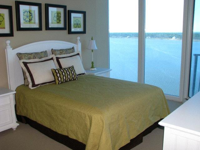 This queen size bedroom offers beautiful views of Little Lagoon - Bel Sole Rental Co - Gulf Shores - rentals