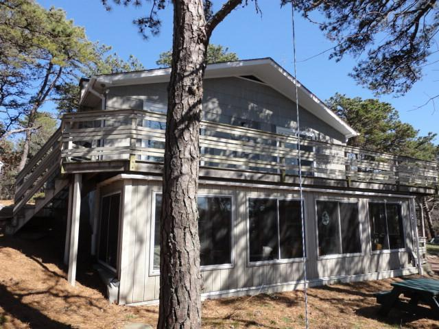 Glassed Porch side with deck above - Bay & downtown  approx.  1/2  mile  Four bedrooms - Wellfleet - rentals