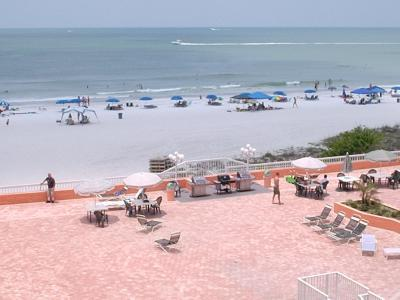 Deck and beach shot from condo balcony - SPECIAL SPECIAL!!!  MAY 14TH-21ST  $795.00 TOTAL - Indian Shores - rentals