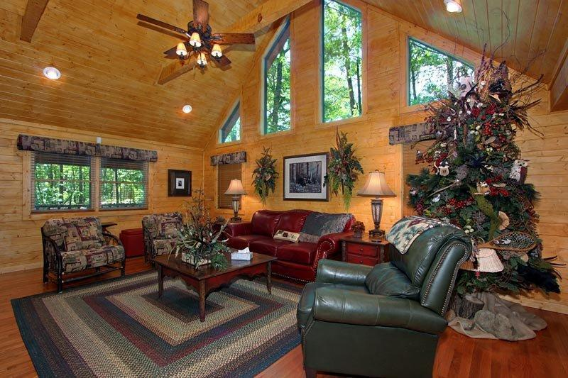 2nd seating area around 2 way stone stacked fireplace, seating for 10 comfortably - STAG'S LEAP-Location, Location, Location - Sevierville - rentals