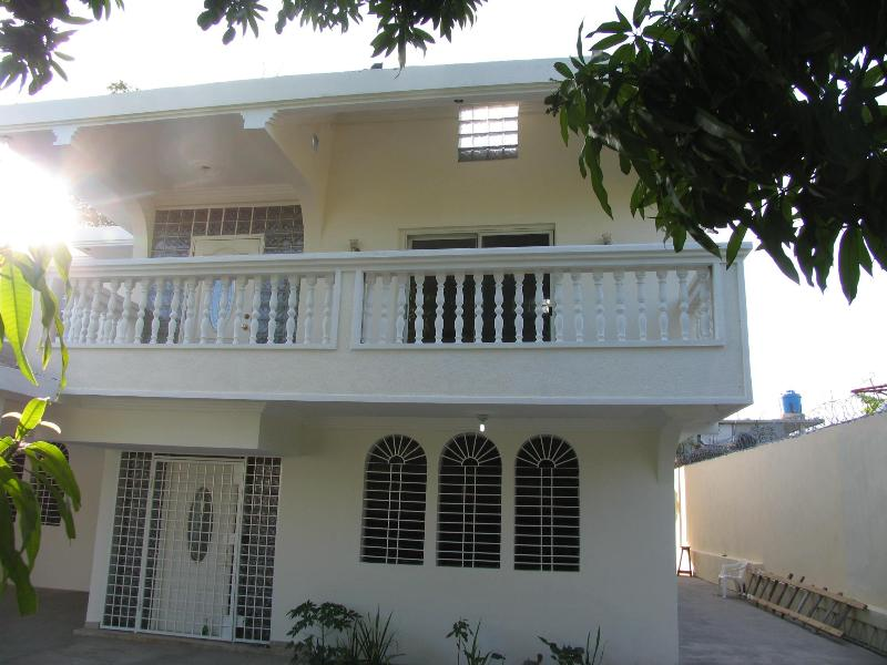 Guests will enjoy a fully equipped kitchen, satellite TV and high speed wireless internet. - 6 bd/4 ba Guesthouse in Port Au Prince | Sleeps 24 - Port-au-Prince - rentals