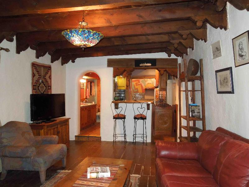 Looking in from front door, study to kitchen (r), bathroom (l) and flows into 4 person hot tub room - Ralph and Rowena Meyers House in Taos, NM - Taos - rentals